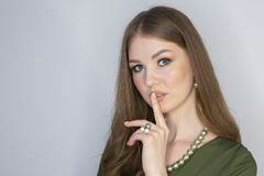 Attractive young girl touching her lips. Photo of blonde girl with perfect skin on grey background. Beauty Skin care concept royalty free stock photos