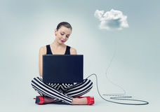 Attractive young girl using laptop computer and cloud computing. Stock Photography