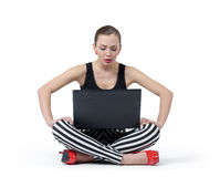 Attractive young girl using laptop computer on white background. Royalty Free Stock Photo