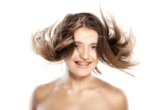 Attractive young girl withh windy hair. Studio portrait of attractive young caucasian girl with messy hair Royalty Free Stock Photography