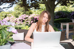 Attractive young girl working in the garden Royalty Free Stock Image