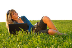 Attractive young girl working in nature Royalty Free Stock Photos