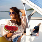 Attractive young girl on a yacht Stock Image