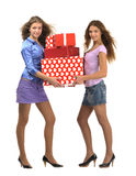 Attractive young girls with gift boxes Stock Images
