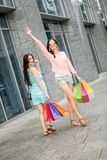 Attractive young girls women on shopping tour Royalty Free Stock Photos