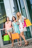 Attractive young girls women on shopping tour Stock Photography