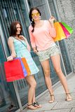 Attractive young girls women on shopping tour Royalty Free Stock Image