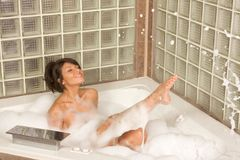 Attractive young gorges woman taking Bubble bath Stock Images