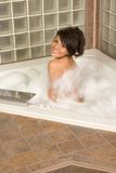 Attractive young gorges woman taking Bubble bath Stock Image