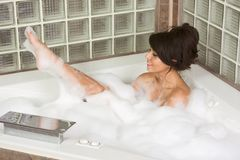 Attractive young gorges woman taking Bubble bath Royalty Free Stock Photo