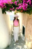 Attractive young Greek woman on the streets of Oia, Santorini royalty free stock images