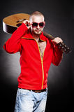 Attractive young guitarist Royalty Free Stock Photography