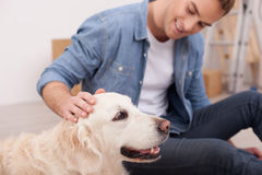 Attractive young guy is caressing his animal Royalty Free Stock Photos