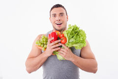 Attractive young guy is fond of fruits and Stock Photo