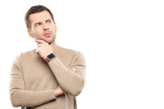 Attractive young guy is making serious decision Royalty Free Stock Photo
