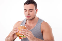 Attractive young guy is refusing to eat unhealthy Stock Photos