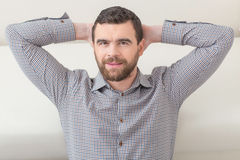 Attractive young guy is relaxing at home Stock Photography