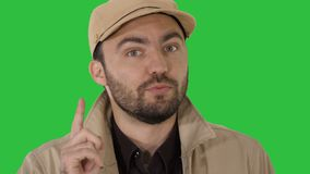 Attractive young guy talking to you Focus, think about it on a Green Screen, Chroma Key. Close up. Attractive young guy talking to you Focus, think about it on stock footage