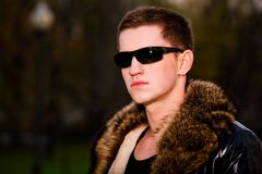 Attractive young guy in winter leather jacket Royalty Free Stock Photography