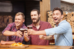 Attractive young guys are resting in sport bar Royalty Free Stock Images