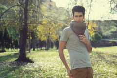 Attractive young handsome man, model of fashion in the park Stock Photography