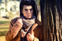 Attractive young handsome man, model of fashion in a park Stock Photo