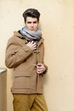 Attractive young handsome man, model of fashion in urban backgro Stock Images