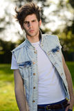 Attractive young handsome man, model of fashion in urban backgro Royalty Free Stock Photos