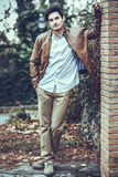Attractive young handsome man, model of fashion in urban backgro Stock Image