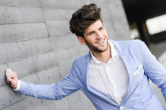 Attractive young handsome man, model of fashion in urban backgro Stock Photo