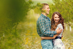 Attractive young happy couple on a spring garden Royalty Free Stock Image