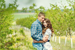 Attractive young happy couple on a spring garden Stock Photo