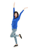 Attractive young happy woman raised her arm Stock Photos
