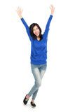 Attractive young happy woman raised her arm Royalty Free Stock Image