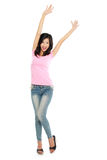 Attractive young happy woman raised her arm Royalty Free Stock Photography