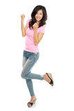 Attractive young happy woman raised her arm Stock Image