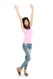 Attractive young happy woman raised her arm Stock Photography