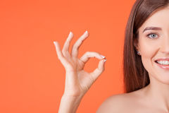 Attractive young healthy girl is gesturing Stock Photos