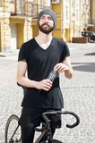 Attractive young hipster guy is cycling in city Royalty Free Stock Photography