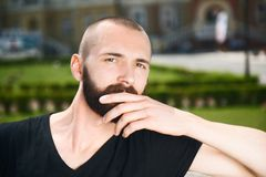 Attractive young hipster guy is having rest Stock Photography