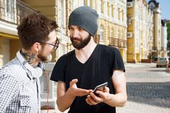 Attractive young hipster guys are having Royalty Free Stock Images