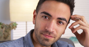 Attractive young hispanic man smiling at camera Royalty Free Stock Photos