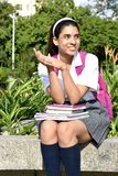 Cute Colombian Girl Student Portrait Wearing Uniform With Books Sitting