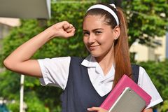 Strong Catholic Colombian Student Teenager School Girl. An attractive young hispanic person stock photo