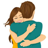 Attractive young hispanic woman hugging her man. With tender love and passion Royalty Free Stock Image