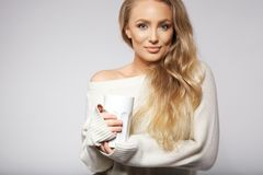 Attractive young with a hot cup of coffee Stock Images
