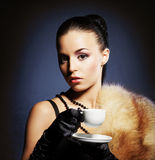 Attractive young lady with the coffee mug Stock Images