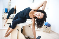 Attractive young lady doing pilates Royalty Free Stock Photography