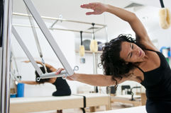 Attractive young lady doing pilates stock photo