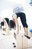 Attractive young lady doing pilates Stock Images